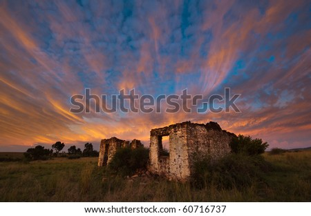 Fiery Sunset over abandoned ruined house