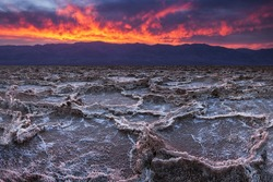 Fiery sunset over Badwater, the lowest point in the United States, California's Death Valley National Park.