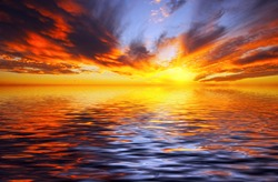 Fiery sunset over the sea in the tropics