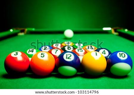 Fifteen billiard spheres lay on green cloth