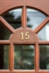 Fifteen in metal digits on a front door