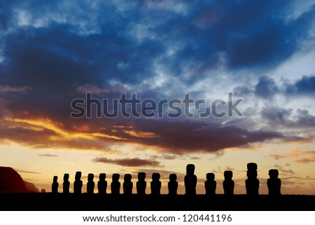 Fifteen standing moai against dramatic evening sky in Easter Island