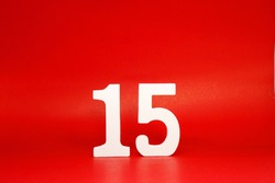Fifteen ( 15 ) white number wooden Isolated Red Background with Copy Space - New promotion 15% Percentage  Business finance Concept