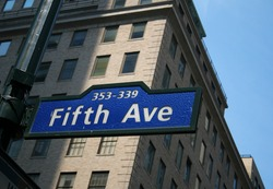 FIfth Avenue Street SIgn in New York City, a popular venue for stores, shops and entertainment in Manhattan, conceptually can represent success, commercialism, retail