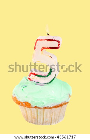 fifth birthday cupcake with green frosting on a yellow background