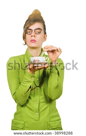 Fifties style young dismissive woman with her tea