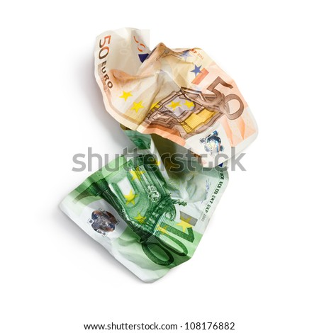 Fifty and hundred crumpled euro banknotes on white background