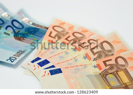 fifty and twenty euro bills on white background