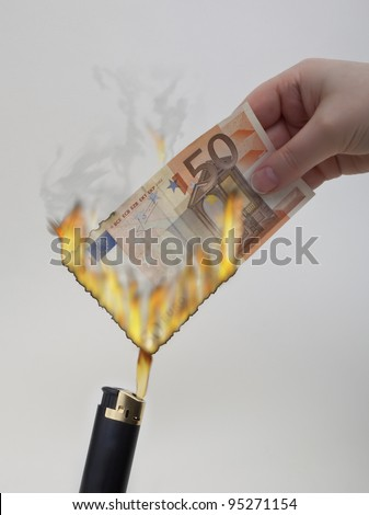 Fifty Euro bank note being set alight with a cigarette lighter