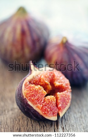 Fig fresh fruit closeup on a wooden table . - stock photo