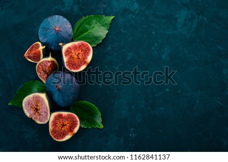 Fig. Fresh fruit figs on a stone black table. Free space for text. Top view. #1162841137