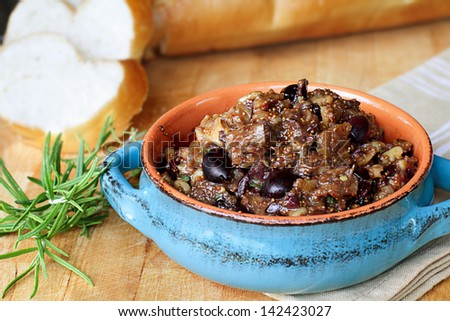 Fig Tapenade prepared with figs, kalamata olives and fresh herbs.