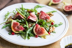 Fig with Pomegranate, Rocket and walnut salad