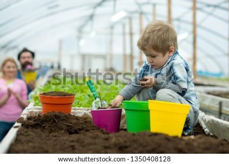 fight pollution. small boy farmer fight pollution. fight pollution by growing plants. fight pollution concept. green life