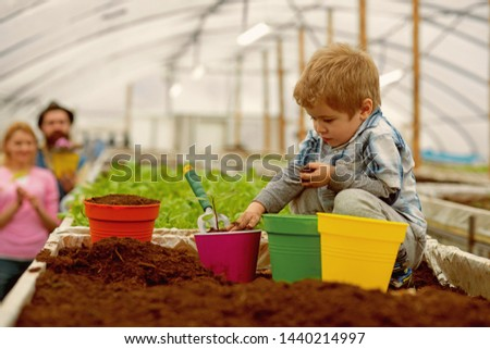 fight pollution. small boy farmer fight pollution. fight pollution by growing plants. fight pollution concept. green life #1440214997