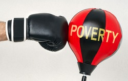 Fight the poverty and misery concept with a strong man's hand in a boxing glove hits the punching bag with text Poverty. Motivation background.