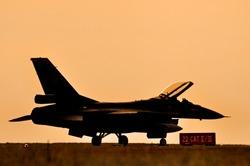 Fighter aircraft sunset