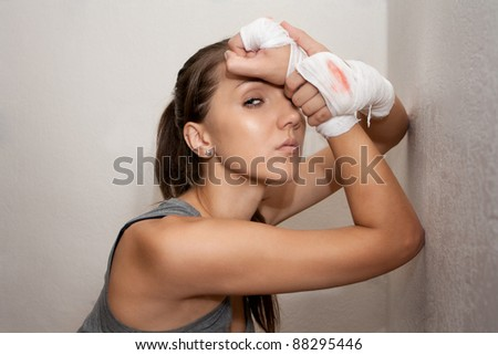 fighter girl with bandage on hands after fight