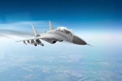 Fighter jet fly hight speed combat mission above the clouds