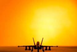 Fighter jet scale model (toy) in a sunset scenary.