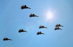 Fighter jets flying under blue sky