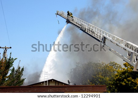 Fighting A Fire From A Tall Ladder