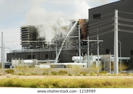 Fighting a fire in the cooling tower at an electricity generating plant.