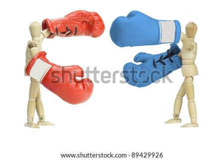 Fighting political parties, symbolized by wooden  mannequins with boxing gloves - stock photo