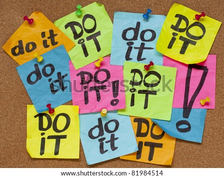 fighting procrastination concept - do it phrase on color sticky notes posted on a cork bulletin board - stock photo
