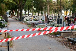 Fighting the pandemic. Closed cemetery due to COVID-19 SARS-CoV-2 outbreak. It is forbidden to visit the cemetery.