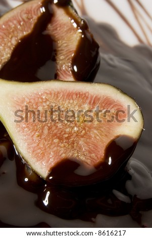 figs and chocolate still life isolated over white background