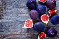 figs on a dark wood background. tinting. selective focus on the middle figs slice