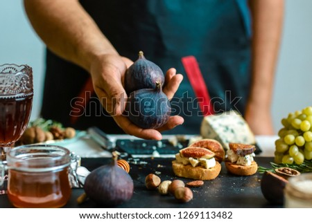 Figs - whole figs - figs in hands in the kitchen. copy text menu. #1269113482