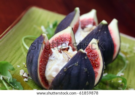 Figs with nut and honey cheese. Shallow dof
