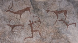 Figure animals and hunter on the stone wall of the cave paint ocher ancient prehistoric Neanderthal. prehistoric animal, stone age hunting for deer