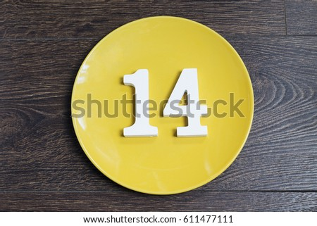 Figure fourteen on the yellow plate and brown background. #611477111