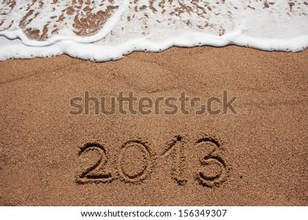 Figure in 2013 was written on the sea shore #156349307
