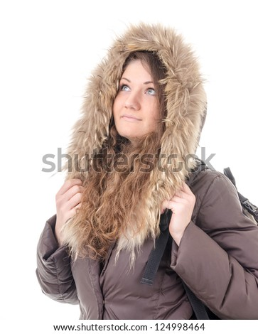 Figure of a girl - tourist in winter clothes #124998464