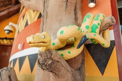 Figure of a yellow snake with venomous pattern at the entrance to the Serpentarium entertainment and tourist center