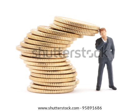 Figure of businessman and stack of coins
