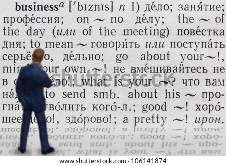 "Figure of businessman who thinks about meaning of word ""business"" written in russian language"