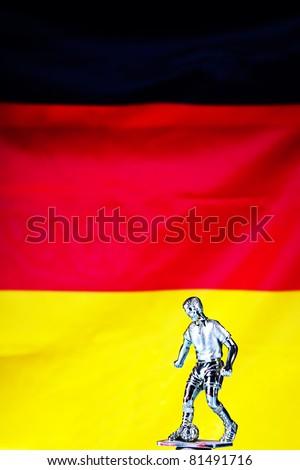 figure of football player and german flag