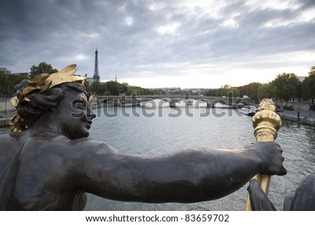 Figure on the Alexandre III Bridge looking towards the Eiffel Tower, Paris, France