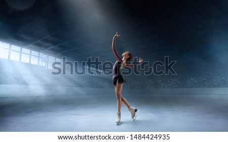 Photo of  Figure skating couple in professional ice arena.