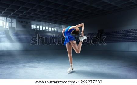 Figure skating girl in ice arena