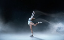 Figure skating girl skating on ice.