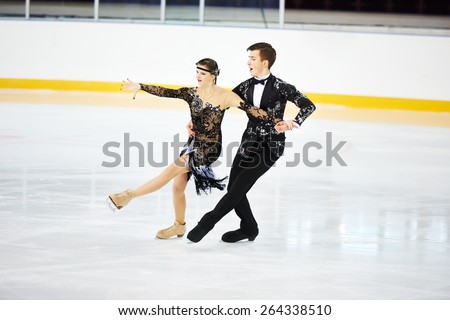 figure skating of young skaters pair at sports arena #264338510