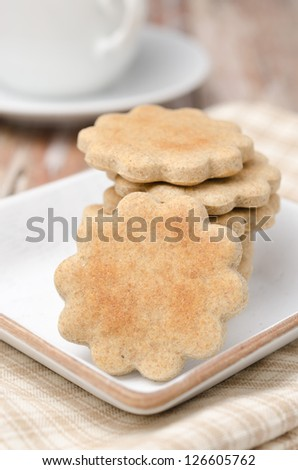 figured cookies on a plate and a cup of tea closeup - stock photo