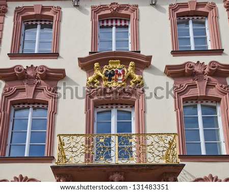 Figures of lions holding coat of arms (facade of old city hall circa 1741). Offenburg, Baden-Wurttemberg, Germany