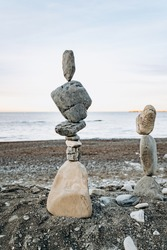 Figures of stones on the beach. Beautiful figures of stones on the background of the sea.